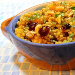 Couscous Fruit Salad Recipe - Couscous simmered with dates, raisins, and dried cranberries is a sweet accompaniment to pork or a nice fruit salad for brunch.