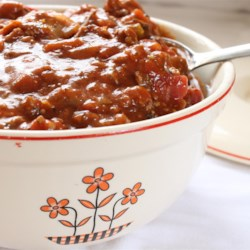 Bobbie's Spaghetti Sauce Recipe - Homemade tomato sauce is always a joy to have for pasta. This recipe calls for a handful of spices to simmer in a mixture of tomato paste, tomato sauce, and diced tomatoes with green chile peppers, as well as ground beef and sliced sausage, to simmer slowly on the stove.