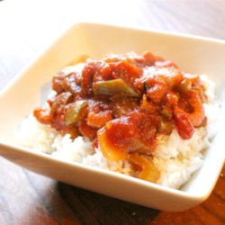 Louisiana Shrimp Creole II Recipe - Tomatoes and shrimp cooked up with garlic and onions - this Gulf Coast tradition will have you dreaming of the bayou. This recipe can either be a main dish or a side dish. You can make it as hot as you want, just add more chili powder and hot sauce.  Serve over hot rice.