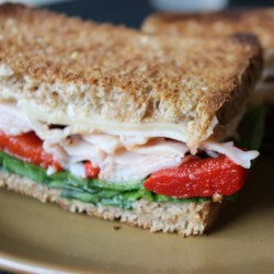 Grilled Turkey and Swiss Sandwich Recipe - Layer your leftover turkey, Swiss cheese, and spinach between thick-cut slices of rye bread and broil for a tasty day-after-Thanksgiving lunch.