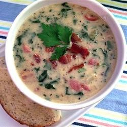 Rich Italian Sausage and Potato Soup Recipe - Strips of kale, cream, and cooked sausage are added in the final stage to this potato soup made with onions and pancetta cooked in chicken broth.