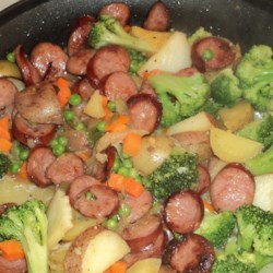Easy Kielbasa Skillet Dinner Recipe - Kielbasa quickly turns into a one-dish meal when you add potatoes and broccoli.