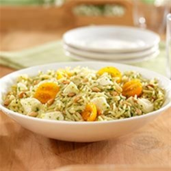 Orzo Pasta Salad with Basil Pesto, Cherry Tomatoes and Fresh Mozzarella Recipe - This colorful orzo pasta salad with fresh mozzarella cheese is ready to serve in less than 30 minutes.