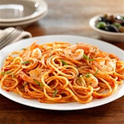 Spaghetti with Shrimp and Tomato and Basil Sauce Recipe - Tomato basil sauce with shrimp make a delicious combo in this quick and easy spaghetti dinner.