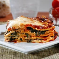 Wavy Lasagna with Meat Sauce, Fresh Ricotta and Spinach Recipe - Classic lasagna with layers of ricotta cheese, meat sauce, Parmigiano cheese and lasagna noodles makes a hearty family favorite.