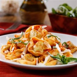 Three Cheese Tortellini with Traditional Sauce and Parmigiano Cheese  Recipe - Cheese-filled tortellini are served in a traditional pasta sauce with shredded cheese and basil.