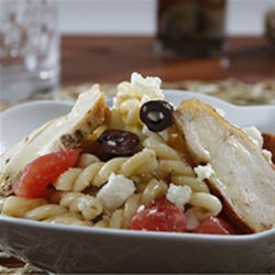 Gemelli Pasta Salad Greek-Style with Pan-Roasted Chicken Breast Recipe - This pasta salad with Greek olives, feta cheese, and sliced grilled chicken makes a great lunch or dinner.