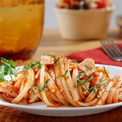 Linguine with Clams and Spicy Marinara Sauce Recipe - Steamed clams in a spicy marinara sauce is a delicious pasta classic.
