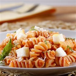 Rotini with Tomato and Basil Sauce and Mozzarella Recipe - Rotini pasta is tossed with tomato and basil sauce with garlic and blended with lots of shredded mozzarella and Parmigiano cheese; dinner's on the table in 15 minutes!