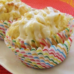 Pina Colada Muffins Recipe - A tasty tropical muffin with the flavors of pineapple, coconut and rum.
