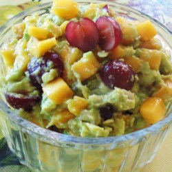 Fruity Guacamole Recipe - Grapes and peaches mix with avocado in this unique guacamole-style dip.