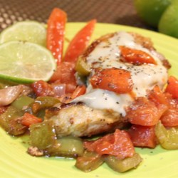 Tomato-Lime Chicken Recipe - This tomato and lime chicken topped with provolone cheese is a quick meal to prepare on weeknights. Serve by itself or with pasta.
