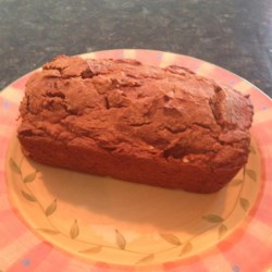 Low-Fat Pumpkin Chocolate Chip Bread Recipe - This pumpkin chocolate chip bread is made lower in fat thanks to egg whites substituted in the batter. Serve during the holiday season!