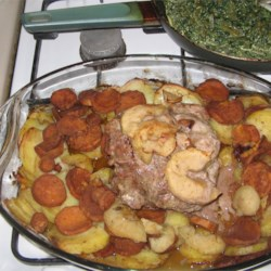 Cinnamon Pork Loin and Potatoes Recipe - Tender pork loin roast is cooked with apples, potatoes, and sweet potatoes, then smothered in a rich gravy.