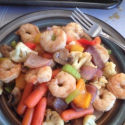 Shrimp Stir Fry Recipe - Frozen stir-fry vegetables make this shrimp dish quick and easy to pull together. You'll have dinner ready in less than 30 minutes.