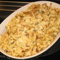 Kaese Spaetzle Recipe - A tasty homemade pasta tossed with onion and Emmentaler cheese. A German version of macaroni and cheese.