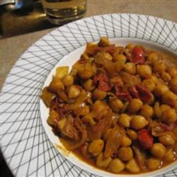 Delicious Chana Masala Recipe - A delicious traditional vegetarian Indian dish of chickpeas, onions, and tomatoes you can have ready in under an hour.
