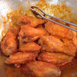 Original Buffalo Wings Recipe - Cook these mini wings in a deep fryer, then add the peppery butter sauce just before serving.
