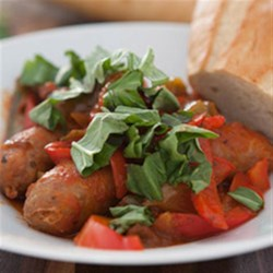 Slow Cooker Sausage and Peppers Recipe - All you do is brown the Italian sausages and your slow cooker does the rest in this warming dish with colorful bell peppers, rich tomato sauce, and fresh basil.