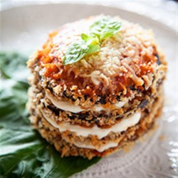Crispy Eggplant Parmesan Stacks Recipe - Eggplant rounds are breaded and baked, then stacked and layered with Ragu(R) Old World Style(R) Traditional Sauce and mozzarella cheese, then baked again until hot and cheese has melted.