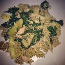 Salmon Pasta with Spinach and Artichokes Recipe - Pesto-coated salmon flavors this colorful spinach and artichoke pasta dish.