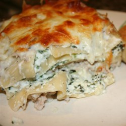 Chicken Lasagna I Recipe - Layer lasagna noodles with tasty bits of chicken, three kinds of cheese and a heavenly mushroom sauce to make a very special baked entree.