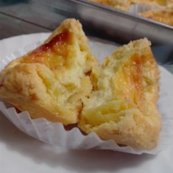 Portuguese Egg Tarts Recipe - Using a boxed pie crust mix makes these sweet and golden Portuguese egg tarts so easy to make.