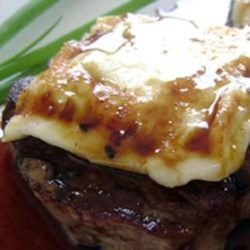 Mom's Medallions of Beef Recipe - Beef tenderloin sliced into medallions are cooked in butter and topped with ham and cheese in this luxuriant entree idea.