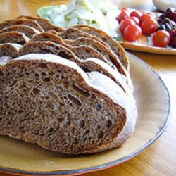 Montana Russian Black Bread Recipe - Black bread, made with dark beer, coffee, molasses, and caraway seed, is a hearty Russian-inspired bread perfect for toast, sandwiches, or alongside soup.