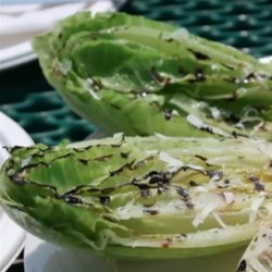 Grilled Hearts of Romaine Recipe - This amazingly simple and quick recipe for grilled romaine will delight with its contrasts of tastes and textures.
