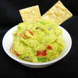 Mom's Awesome Guacamole Recipe - Sour cream brings extra creaminess to the 'awesome' guacamole made with this recipe.