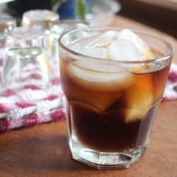 Super Root Beer Recipe - Spiced rum and root beer-flavored schnapps are mixed with cola creating a super root beer mixed drink.