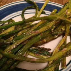 Lemon Asparagus Recipe - Simply roasted asparagus is tossed with a lemon butter sauce for a quick and easy side dish.