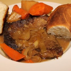 Johnny's Slow Cooker London Broil Recipe - Carrots and potatoes are slow cooked with London broil steak to make a comforting one-dish meal with a delicious gravy.