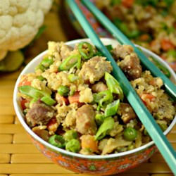 Cauliflower Fried 'Rice' Recipe - Enjoy this cauliflower fried 'rice' packed with green onions, peas, eggs, pork, and garlic.