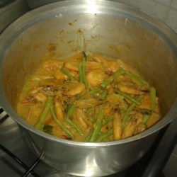 Guinataan Sitaw and Kalabasa (String Beans and Squash Stew) Recipe - In this one-pot meal of string beans, squash, pork, and prawns, the coconut milk adds richness and flavour.