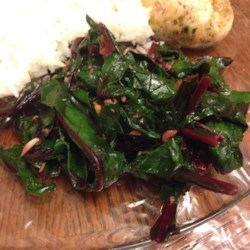 Simple and Delicious Beet Greens Recipe - Don't throw away those hearty green leaves that top fresh bundles of beets! They have a flavor similar to kale.  This simple recipe will will help you make the most of your fresh beets!