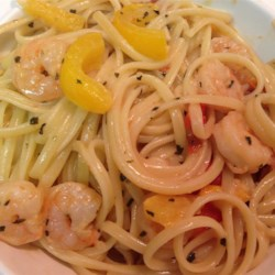 Scrumptious Shrimp Scampi Linguine Recipe - Tender pink shrimp and red and yellow bell pepper simmer in a flavorful garlic sauce with a hint of cream and the zing of crushed red peppers, all tossed with linguine and served hot.