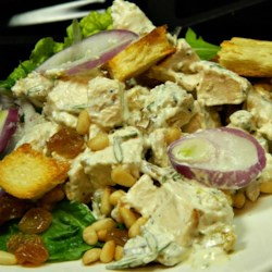 Chicken Salad With Pine Nuts and Raisins Recipe - It 's hard to say whether the incredibly tasty dressing or the fabulous salad fixings are the star of this recipe. The sour cream/mayonnaise dressing has mustard, honey and rosemary. The salad has golden raisins, pine nuts, red onion rings, lots of chicken and two kinds of fresh greens. It 's a toss up.