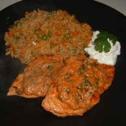 Chipotle Chicken Recipe - Smokey chipotle peppers make an intense marinade for chicken cooked with sour cream and tender baby spinach.