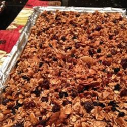 Addictive and Healthy Granola Recipe - Make your own addictive granola using oats, puffed rice, coconut, nuts, and dried fruit. Rosewater is the secret ingredient!