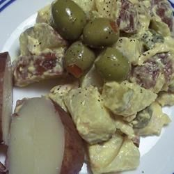 Easy Salad Olivieh Recipe - This Russian salad of potatoes, chicken, and olives is eaten in many Mediterranean countries as well. Serve cold, with warm flatbread or pita bread