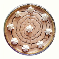 Chocolate Bar Pie II Recipe - Chocolate almond candy bars are melted with marshmallows, cooled, and folded into whipped cream. This lovely concoction is then spooned into a graham cracker crust and chilled before serving.