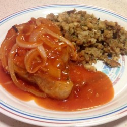 Pork Chops in Red Sauce Recipe - Tender pork chops baked in an easy to make tomato sauce.