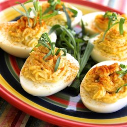 Tarragon and Spice Deviled Eggs Recipe - No holiday meal is complete without deviled eggs. Tarragon and spicy horseradish add a festive note to the classic.