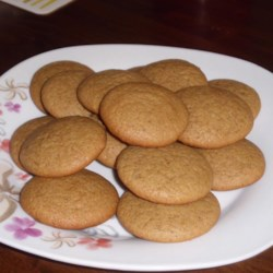 Ginger Creams Recipe - Spicy ginger cookie frosted with a confectioners' sugar icing.