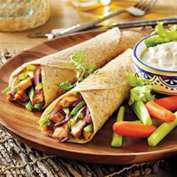 Buffalo Chicken Tacos from Mission(R) Recipe - Spicy grilled chicken breast slices are rolled into tortillas with strips of bell pepper and red onion. Serve carrot and celery sticks with blue cheese dressing on the side for dipping.