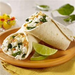 Vegetarian Breakfast Burrito Recipe - Hash browns with spinach, scrambled egg whites, and shredded mozzarella cheese make a quick and hearty breakfast for families on the go.