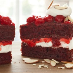 Red Velvet Cherry Torte Recipe - Red Velvet Cherry Torte garnished with icing and toasted almond slivers create this easy and delicious cake.