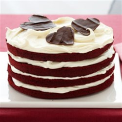 Red Velvet Dream Torte Recipe - Layers of rich Red Velvet Cake with decadent cream cheese frosting are topped with chocolate hearts for an added, loving touch.